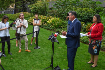 Reporters are kept at a safe distance from Premier Daniel Andrews and Health Minister Jenny Mikakos on Thursday morning.