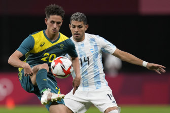 Australia's Lachlan Wales is challenged by Argentina's Facundo Medina.
