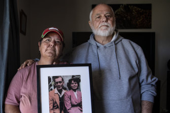 Kim May with her brother, Kenny, holding a photo of their late mother and father. They have serious concerns about the treatment of their mother, Gwendoline May, in a NSW hospital.
