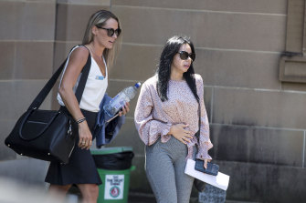 Kristy Torrisi (right) and Senior Constable Ayley Ross leave Darlinghurst court house after giving evidence on Tuesday.