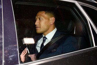 In the balance: Israel Folau leaves a Rugby Australia code of conduct hearing in Sydney.