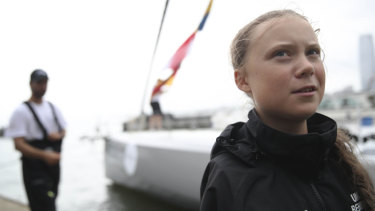 Swedish climate activist Greta Thunberg talks to reporters after arriving in New York via ship.