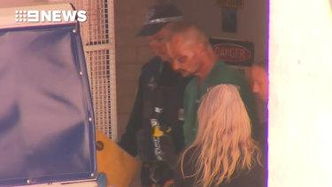 Accused Darwin shooter Ben Hoffmann is taken from hospital into custody.