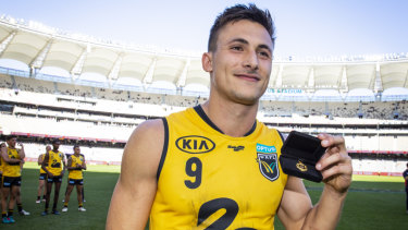 Best in the west: Josh Deluca receives the Simpson Medal after an outstanding season in the WAFL.