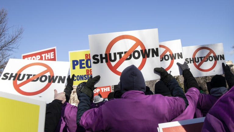 Demonstrators rally against a partial government shutdown at a protest hosted by the National Air Traffic Controllers Association on Capitol Hill in Washington.
