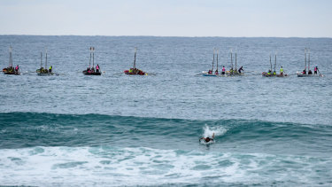 The burial at sea at Currumbin Beach, in which the ashes of 33 servicemen were scattered on the waves by local rowers from surf lifesaving clubs.