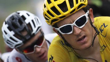 Changing of the guard: Geraint Thomas out in front with Chris Froome trailing.