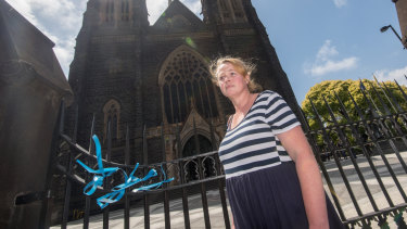 Heather Ryan tied ribbons to the gates of St Patrick's Catherdral in support of victims of sexual abuse by the Catholic Church.
