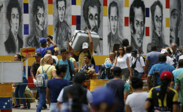 Venezuelans return home through San Antonio del Tachira, a crossing used by locals who shop across the border in Cucuta, Colombia.