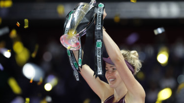 Elina Svitolina celebrates after winning the WTA Finals in Singapore.