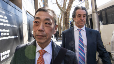 Ernest Wong (centre) arrives at the NSW Independent Commission Against Corruption inquiry.