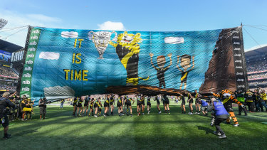 Making AFL banners is a team endeavour – with the writer's mum part of Richmond's effort.