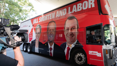 Bill Shorten arrives on his campaign bus – which bears the image of Premier Mark McGowan – before a visit to Royal Perth Hospital on Monday.