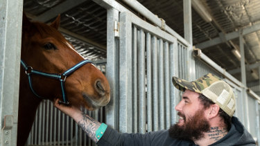 """Returned serviceman Clayton Hellyer with retired racehorse Vashka ... """"People think we save them. They saved me."""""""