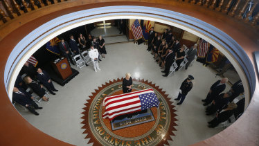 Cindy McCain, wife of John McCain, stands at the casket during a memorial service at the Arizona Capitol.