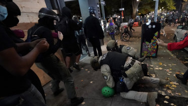Oregon State Police arrest a protester in Portland on Wednesday.