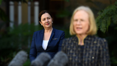 Queensland Premier Annastacia Palaszczuk (left) watches Chief Health Officer Jeannette Young during a press conference at Parliament House in Brisbane.