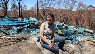 Susan Templeman amid the remains of her razed home after the Blue Mountains bushfire in 2013.