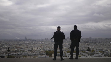 French police guard the Sacre Couer basilica in Paris as the nation's security alert status is set at its highest level.