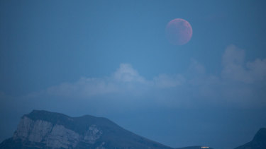 The moon turns red during a total lunar eclipse, as seen from Lucerne, Switzerland.