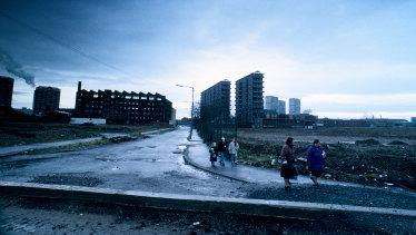 Children walking through housing estate in the Gorbals housing estate, Glasgow.