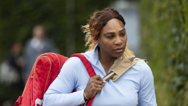 Serena Williams arrives for a practice session at the All England Club.