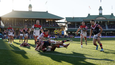 No place like home: Boyd Cordner scores against the Knights.