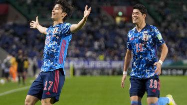 Japan's Ao Tanaka, left, celebrates after scoring his team's first goal.