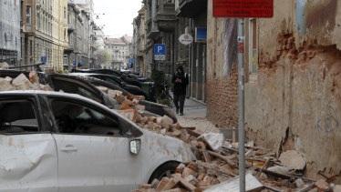 Damaged vehicles and fallen debris after the earthquake in Zagreb, Croatia.