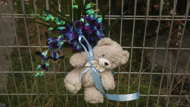 Tributes to the baby boy tied to the fence of the New Lambton home where he was staying before he died.