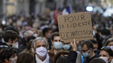 A protester's sign reads: 'For the freedom of speech', at a demonstration in Lyon, central France, after the beheading of history teacher Samuel Paty near Paris.