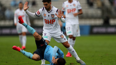 Perth Glory's Bruno Fornaroli stands over Sydney FC's Kosta Barbarouses in their clash at Netstrata Jubilee Stadium on March 14 - one of the final matches of the A-League before COVID-19 forced it into recess.