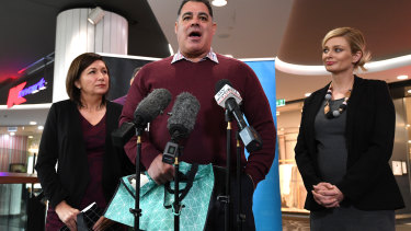 (L-R) Queensland Environment Minister Leeanne Enoch, rugby league legend Mal Meninga and the National Retail Association's (NRA) CEO Dominique Lamb explain Queensland's plastic bag ban which comes into place on July 1.