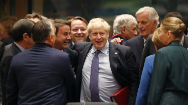 Boris Johnson with the EU's chief Brexit negotiator Michel Barnier (right) and Luxembourg's Prime Minister Xavier Bettel (left) during a round-table meeting on Thursday.