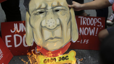 Student activists burn a caricature of Philippine President Rodrigo Duterte during a rally on July 4.