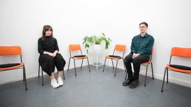 Artists Olivia Tartaglia and Alex Tate in the bureau waiting room.
