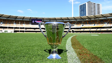 The AFL premiership cup gets comfortable at the Gabba.