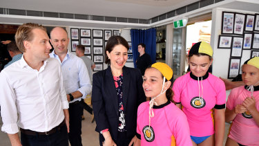 Premier Gladys Berejiklian, Environment Minister Matt Kean and Manly MP James Griffin made the plastics announcement at Queenscliff Surf Lifesaving Club.