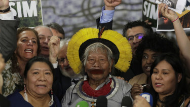 Brazilian indigenous chief Raoni Metuktire attends a meeting with politicians and other organisations in the Brazilian Congress on September 25 .