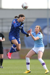 Sam Kerr, left, in action against Manchester City.