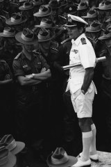 Captain Andrew Robertson addresses officers and men of the 5th Battalion RAR on the flight deck of HMAS Sydney at Garden Island, 1973.