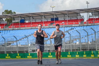 Brett Kuhner and Tim Brook take a slow lap of the track that Formula 1 cars would normally be roaring around.