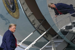 President Donald Trump boards Air Force One at Palm Beach International Airport on December 31, amid rising tensions between the US and Iran.