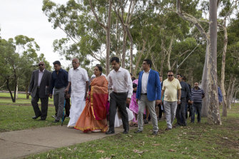 Members of Prabha Kumar's family attend a memorial service for her in 2015.