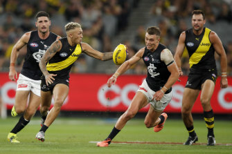 Richmond's Shai Bolton runs away from Carlton's Patrick Cripps.