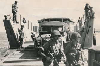 Australian troops and vehicles disembark in Vietnam.