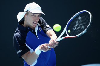 Marc Polmans belts a backhand on the way to beating Mikhail Kukushkin of Kazakhstan on Tuesday.