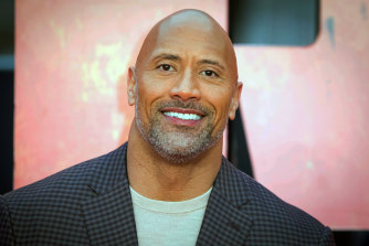 Dwayne Johnson says his relationship with his father was 'fuelled by tough love'.