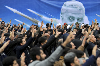 """Protesters in Tehran demonstrate over the US air strike in Iraq that killed Iranian  general Qassem Soleimani. Iran has vowed """"harsh retaliation""""."""