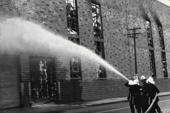 Firemen fighting the blaze on the northern side of the building. February 9, 1971.